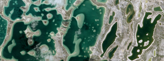 SPOT-6 image (resolution 1.5 m, 23.04.2017), Kiritimati (Christmas Island), Kiribati, © Airbus 2017 - Kiritimati (Christmas Island)  has the greatest land area of any coral atoll in the world, about 388 km2. The main lagoon of Kiritimati gradually turns into a network of numerous subsidiary lagoons.