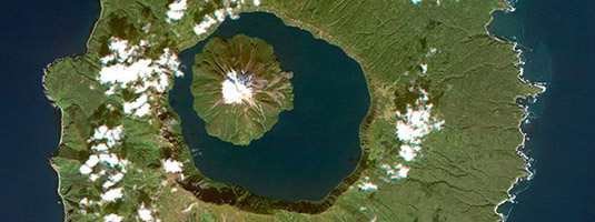 RapidEye image (resolution 6.5 m, 24.9.2013), Onekotan, Kuril Islands, Russia, Copyright © BlackBridge - An island within an island is a peak of stratovolcano Krenitsyn in 7.5 km wide caldera lake on Onekotan island. This caldera was formed during an eruption less than 10,000 years ago.