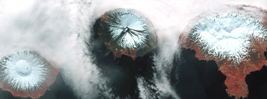 TERRA / ASTER image (30m resolution, August 2010), Chuginadak, Aleutian archipelago. © 2010 NASA - The islands contain restless Mt. Cleveland, an active volcano currently being watched to see if it emits an ash cloud that could affect air travel over parts of North America.